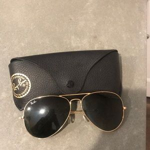 Black aviator RayBans with gold frame